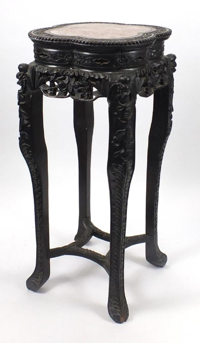 Chinese hardwood plant stand with inset marble top, carved with flower heads and berries, 92.5cm