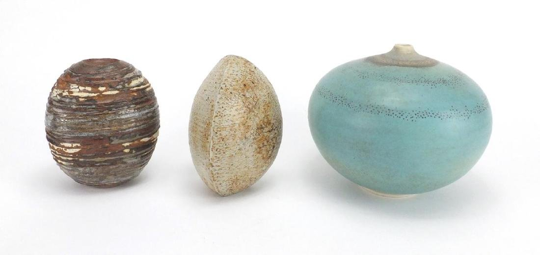 Three studio pottery vases by Alan Wallwork, two of naturalistic form, incised marks to the bases,