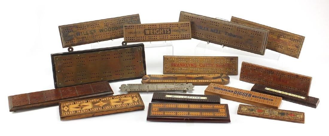 Vintage and later cribbage boards including inlaid Bakelite and advertising examples, the largest