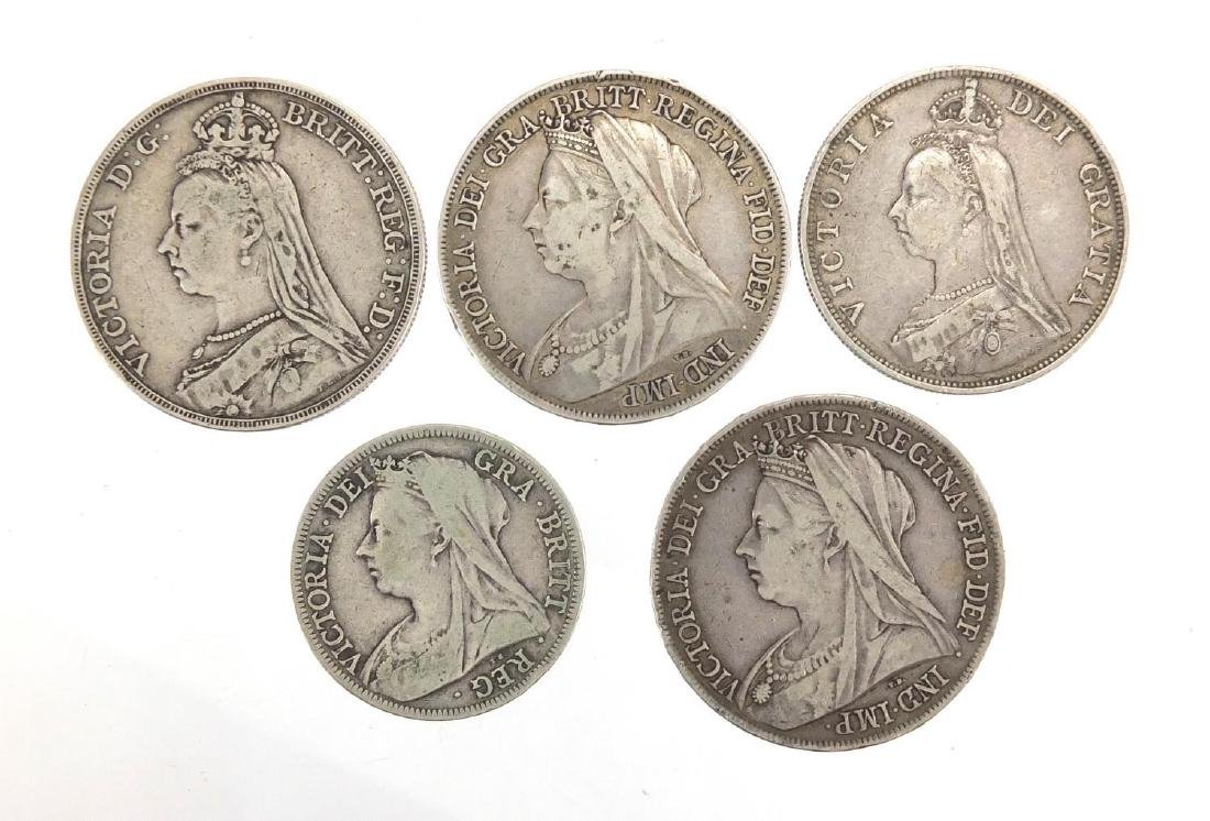 Five Victorian silver coins comprising three crowns, 1891, 1899 and 1899, 1888 double florin and