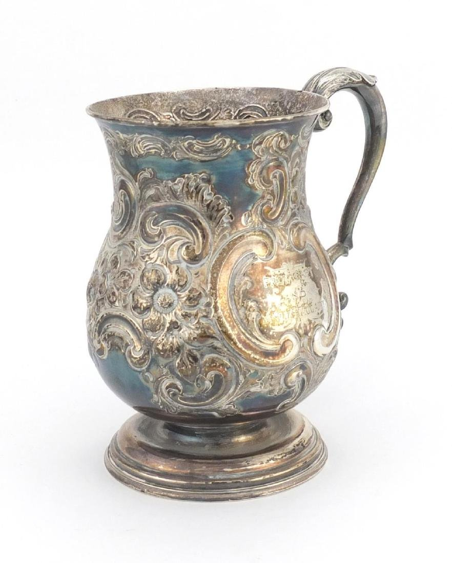 Victorian silver tankard with embossed floral decoration, J.D & S Sheffield 1898, 13.5cm high,
