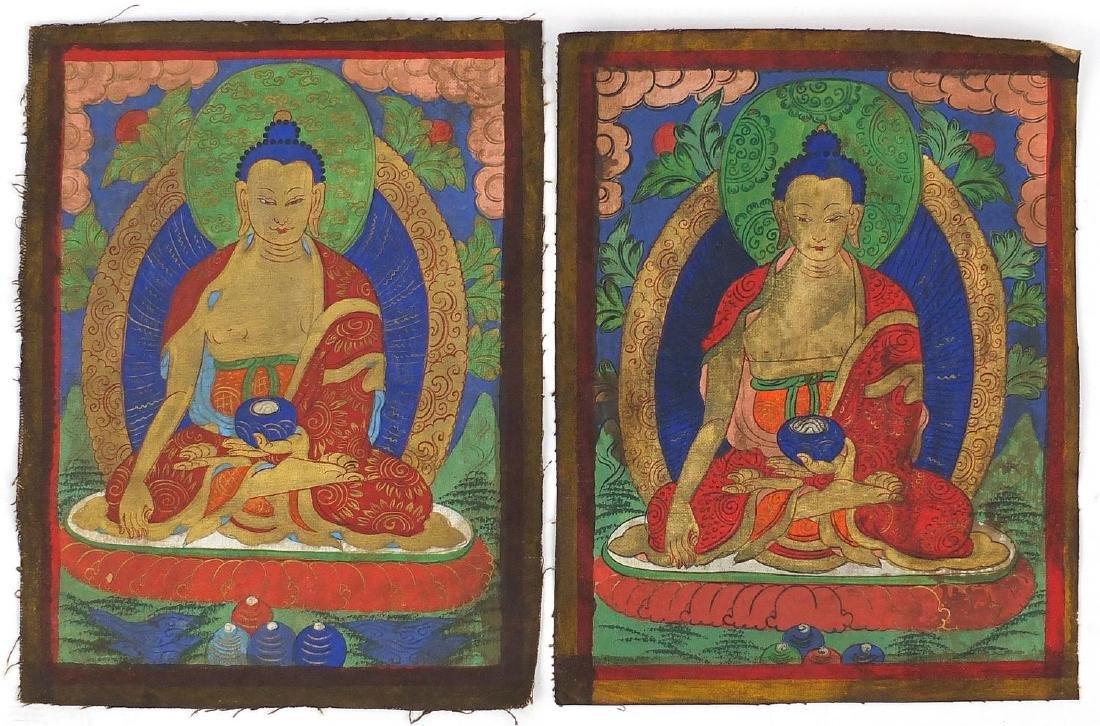 Pair of Sino Tibetan silk panels, both hand painted with Buddha, each 37cm x 28cm Further