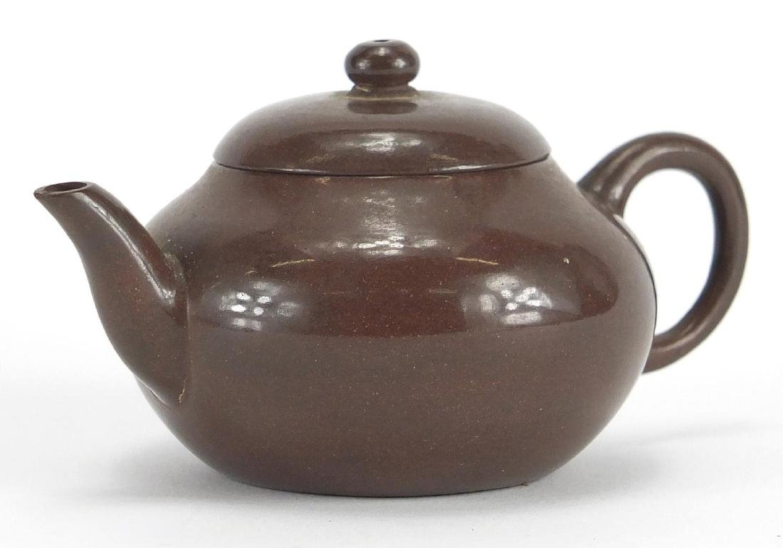Chinese Yixing lustre teapot, incised character marks to the base, 10.5cm in length Further