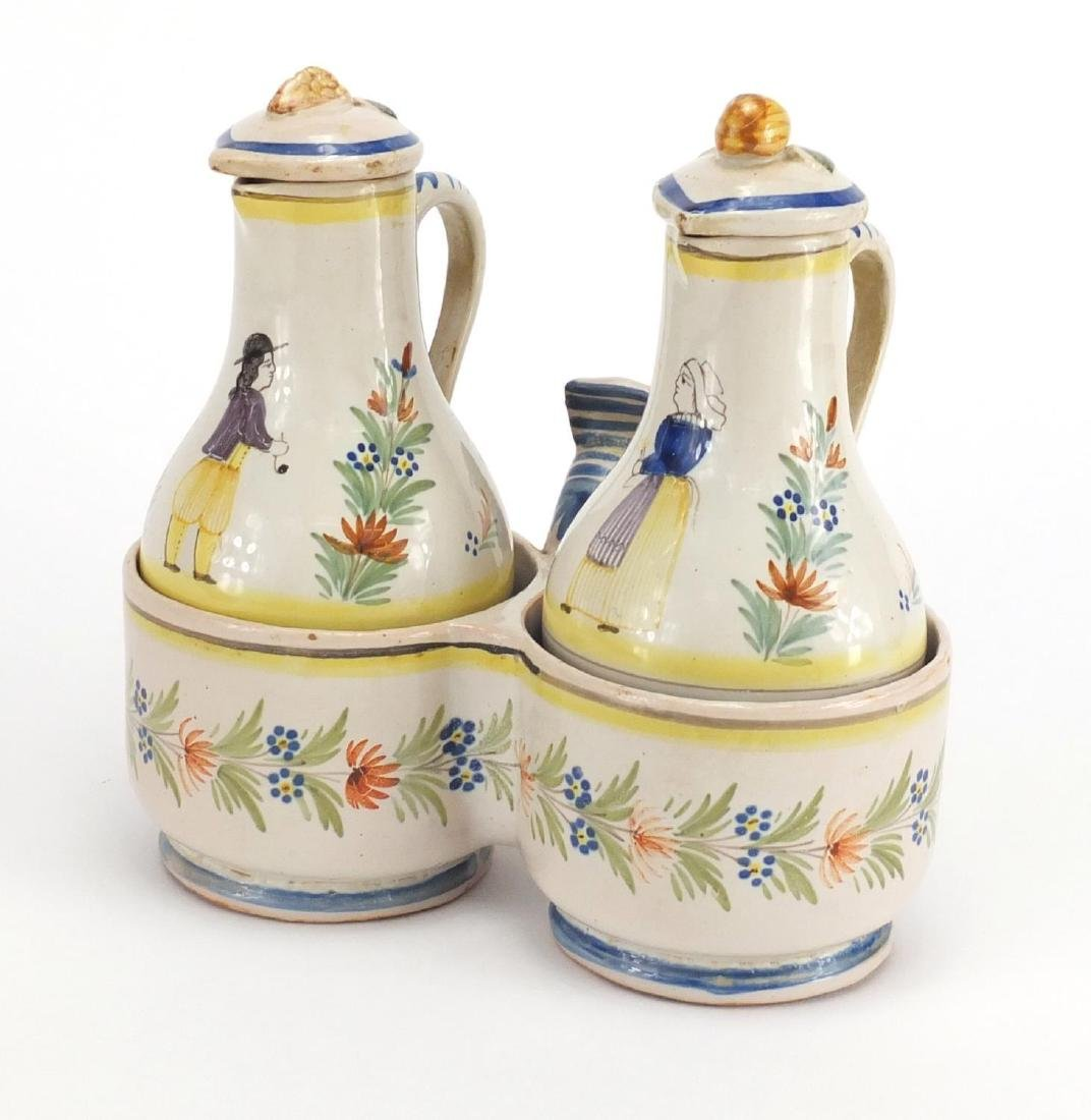 French Quimper pottery oil and vinegar cruet, the bottles hand painted with a traditional lady and