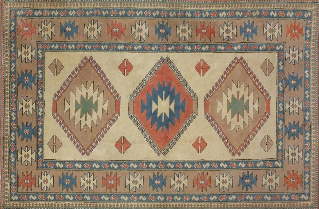 Rectangular Turkish rug having an all over geometric design with corresponding boarders,