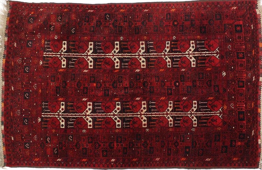 Rectangular Afghan rug with repeat design, approximately 215cm x 130cm
