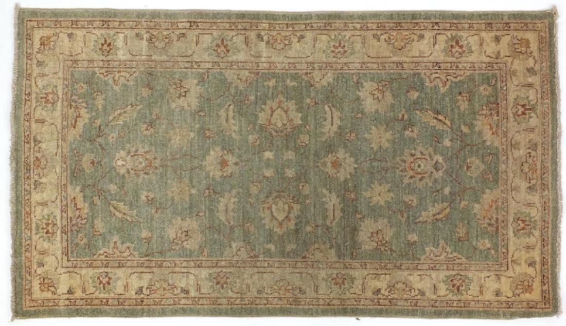 Rectangular Persian Zeigler rug, having a scrolling vine and flower head design, 157cm x 80cm :