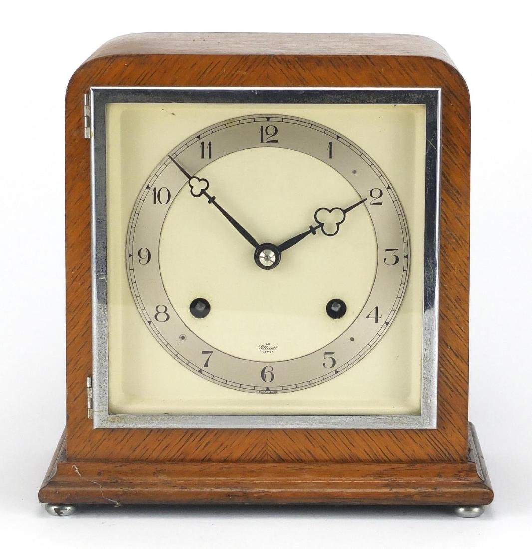 Elliot oak cased mantel clock with silvered chapter ring and Arabic numerals, 22cm high