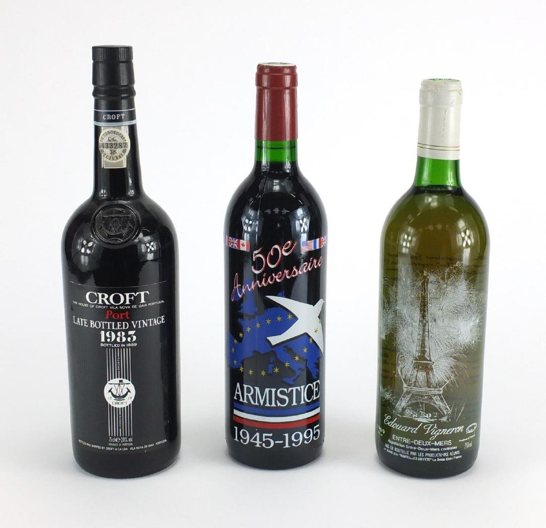 Three bottles of alcohol, late bottle vintage 1983 Croft Port, 50th Anniversary of Armistice
