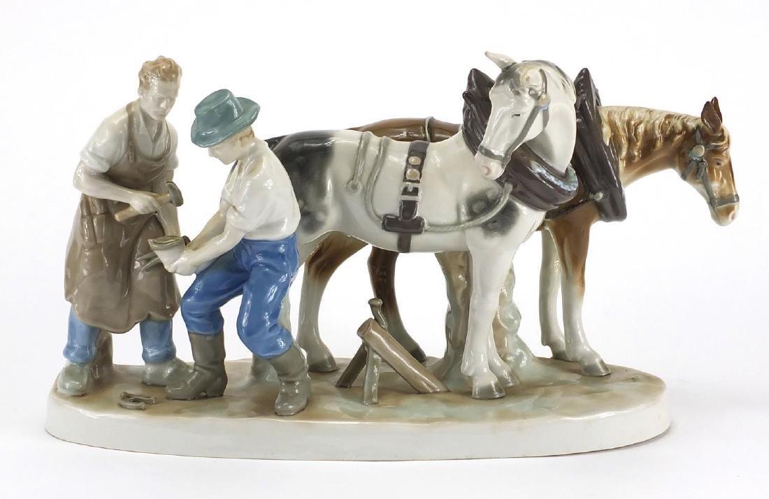 German hand painted porcelain Blacksmith figure group, shoeing horses, 36cm wide