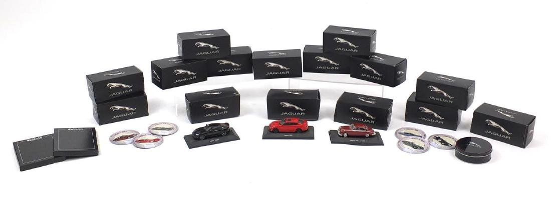 Fourteen Atlas Editon die cast Jaguars and coasters including D type and Mark V Coupe, all boxed :