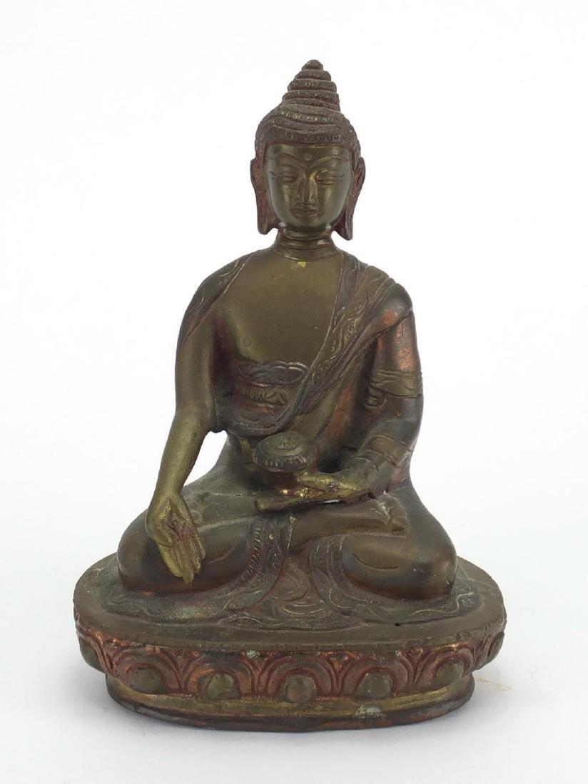 Tibetan figure of Buddha, 18cm high