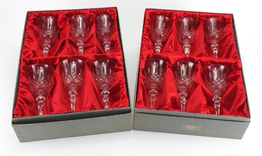 Two sets of six Bohemian but crystal glasses, with fitted boxes, each 17cm high
