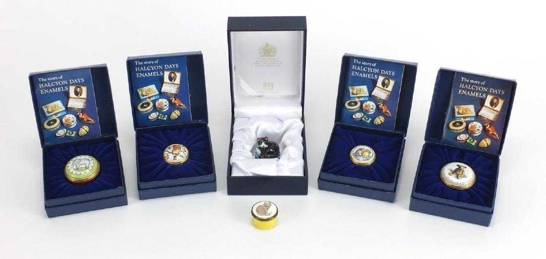 Six Halcyon Days enamelled trinkets and Bonbonnieres, including cat examples, five boxed