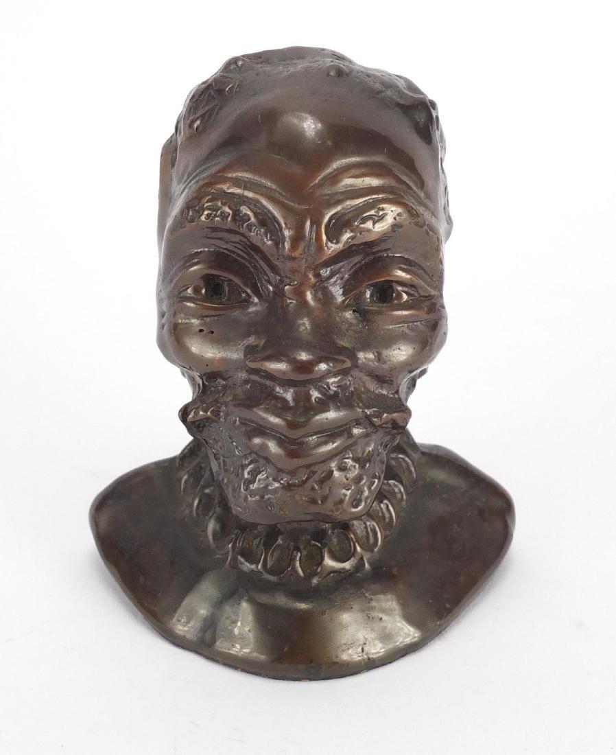 Bronze bust of an African male, 10.5cm high