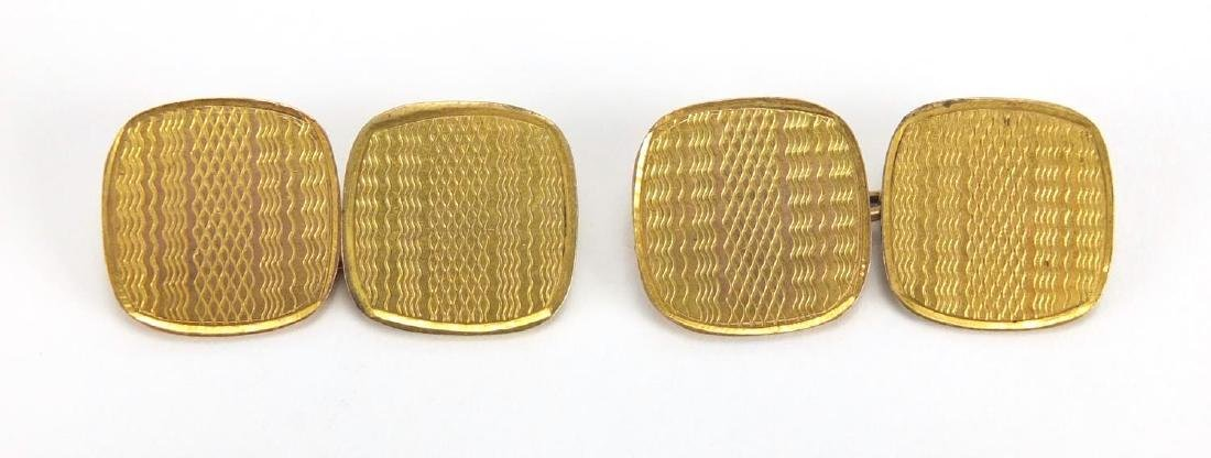Pair of 9ct gold cuff links with engine turned decoration, approximate weight 4.4g