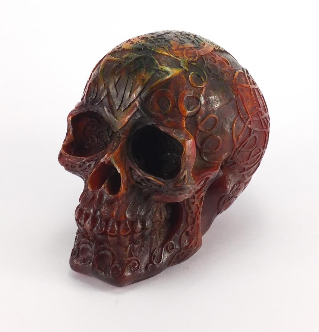 Multi coloured amber style skull, 15cm high