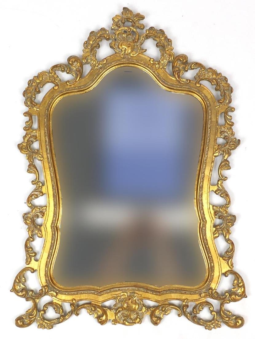 Rococo style wall hanging mirror, decorated with c-scrolls and foliage, 97cm high x 64cm wide :