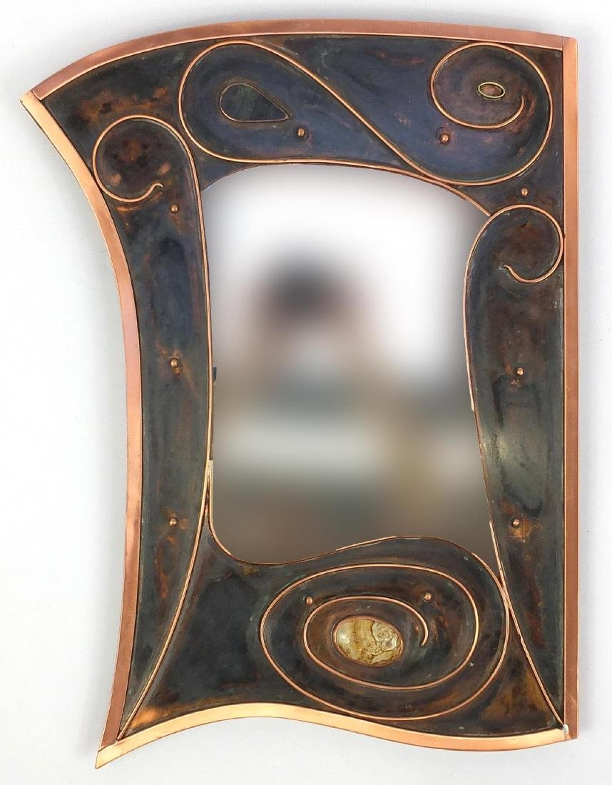 Sam Fanaroff copper mirror of stylised design with inset cabochon stone, 61cm high x 41cm wide