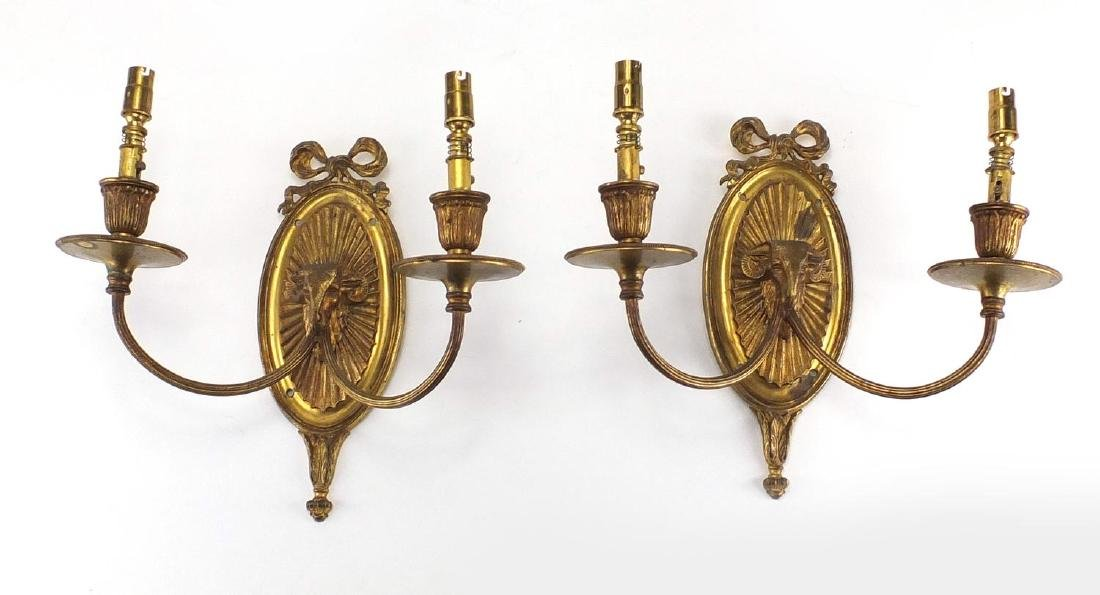 Pair of Ormolu rams head design twin wall sconces, each 27cm high