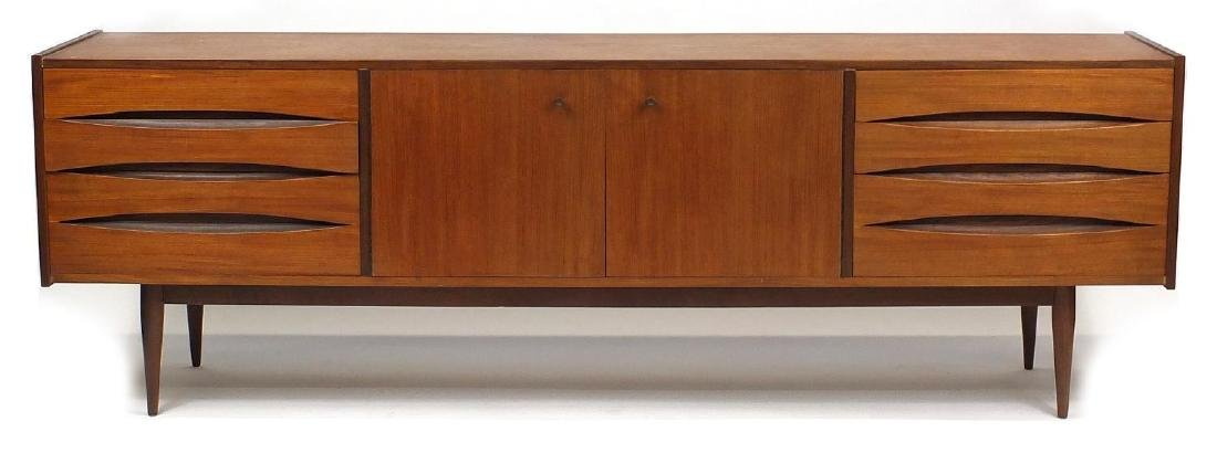 Vintage teak sideboard, possibly Danish fitted with a pair of cupboard doors and eight drawers, 73cm