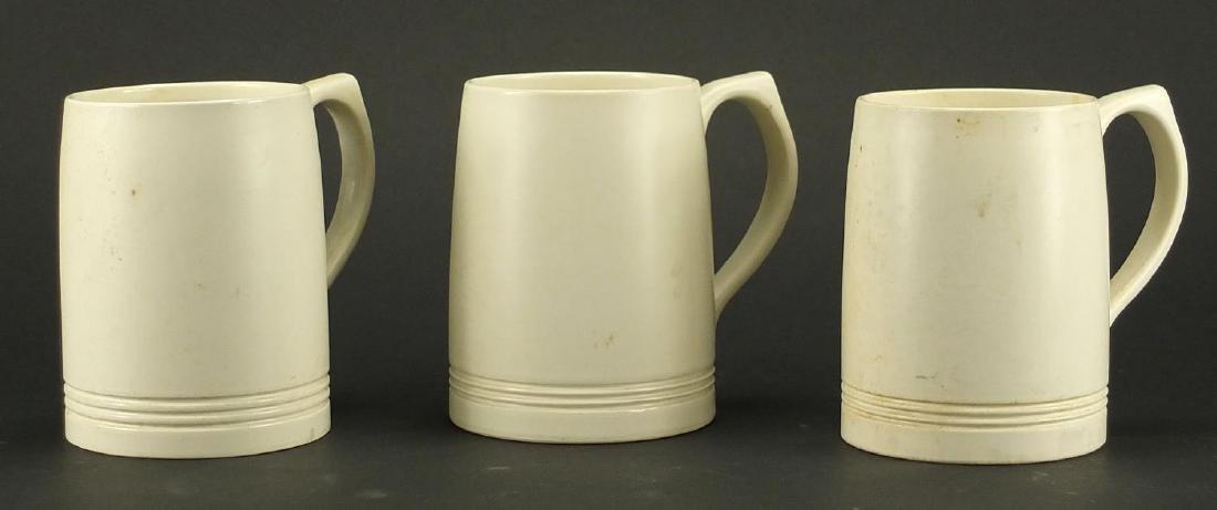Three Wedgwood mugs designed by Keith Murray, each 12.5cm high