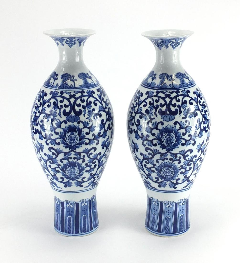 Large pair of Chinese blue and white porcelain vases, hand painted with flower heads and foliate