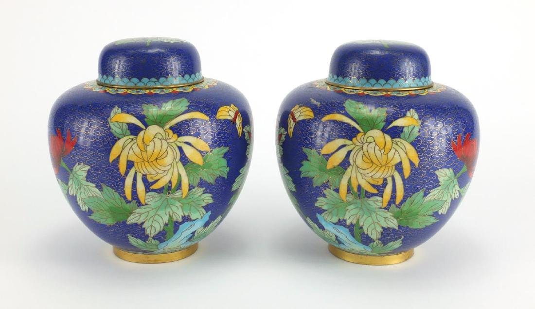 Pair of Chinese cloisonné ginger jars and covers, both enamelled with butterflies and flowers,
