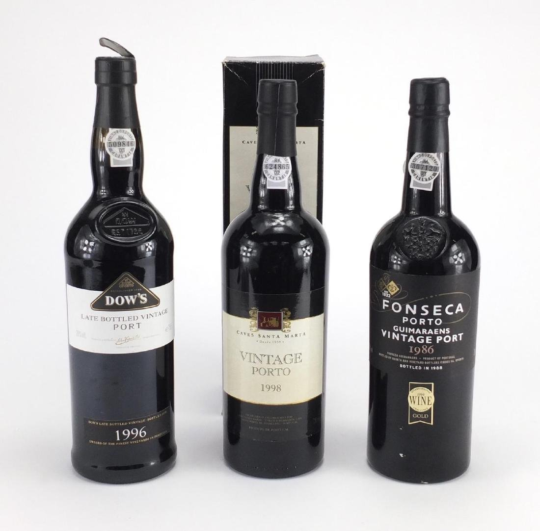 Three bottles of port, 1986 Fonseca, 1996 Dow's and Caves Santa Marta 1998 with box
