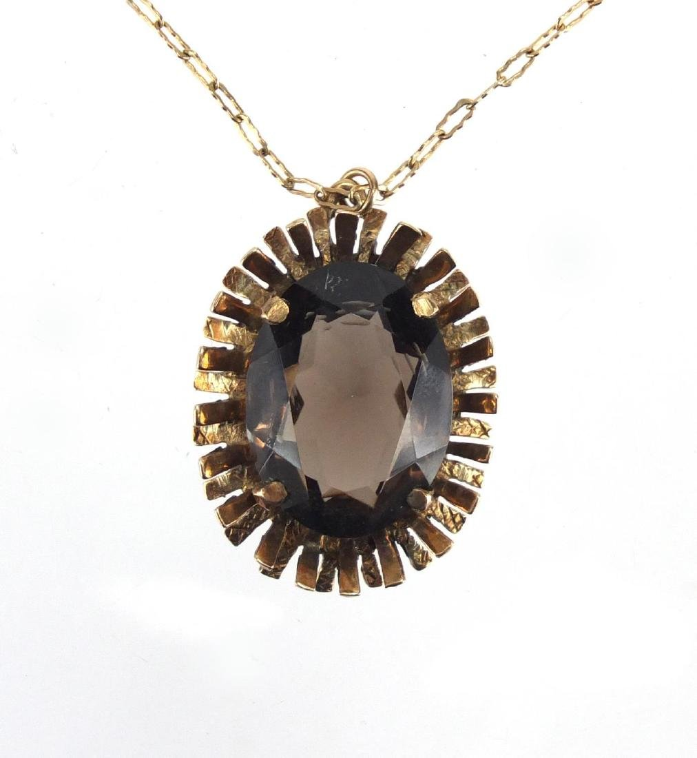 9ct gold smoky quartz pendant on a 9ct gold necklace, the pendant 3cm in length, approximate
