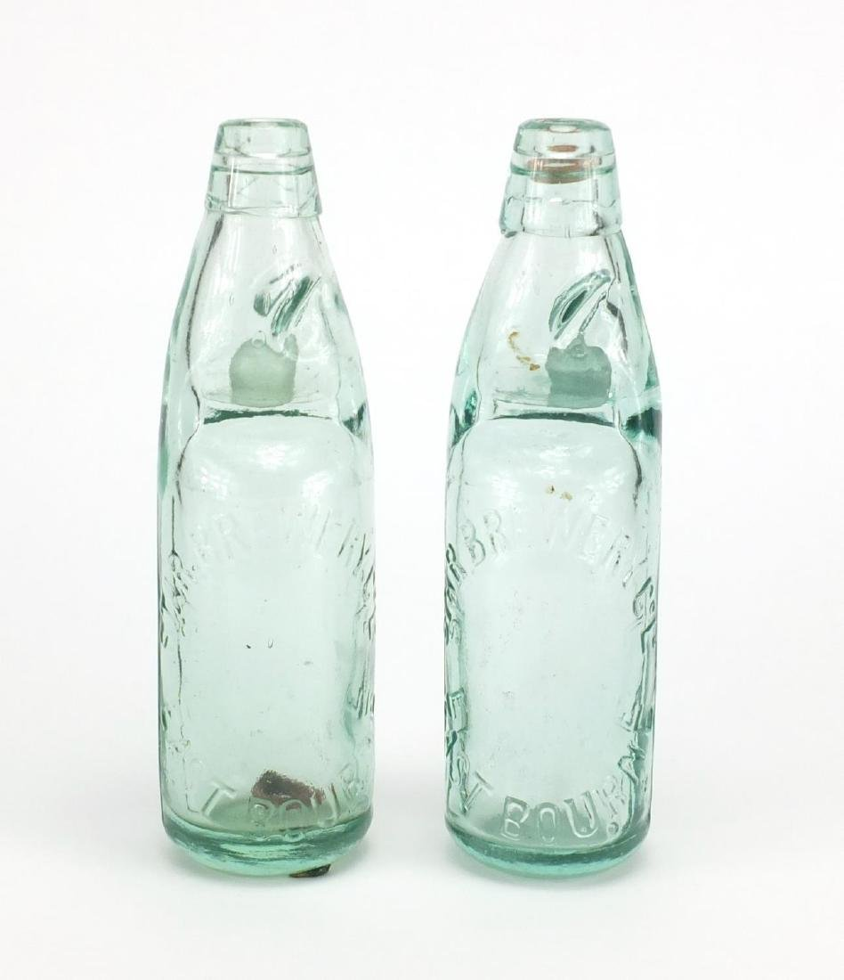 Two advertising interest Star Brewery of Eastbourne glass bottles, each 22cm high