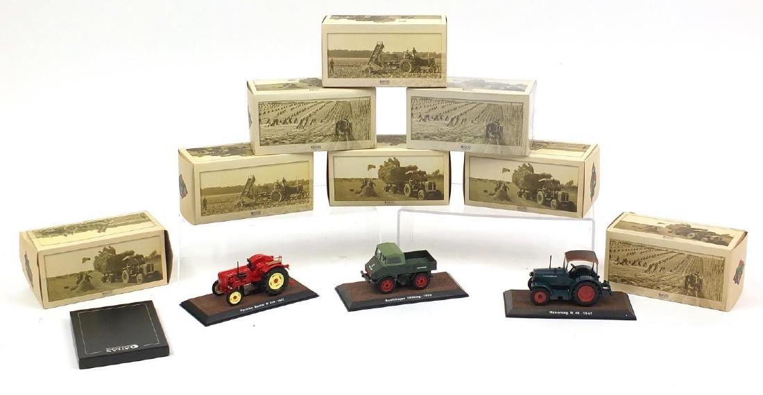 Eight Atlas Edition die cast agricultural vehicles including Boehringer Unimog and Eicher Wotan