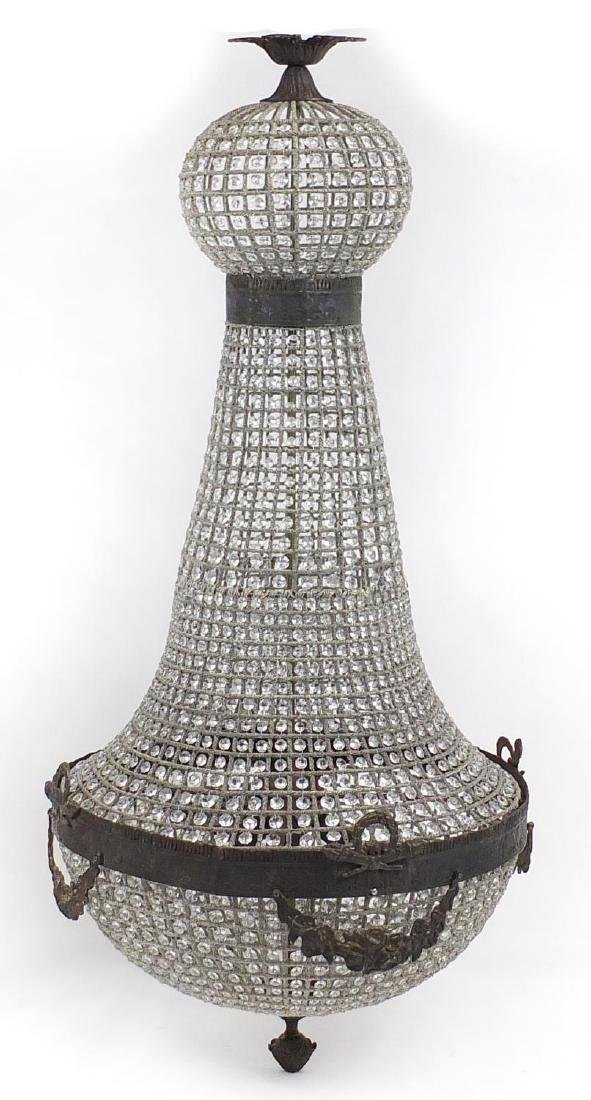 Large glass chandelier with ornate metal mounts, 160cm high