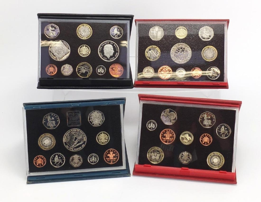 Four Royal Mint United Kingdom proof sets, 2008 Deluxe, 2003, 2004 and 1998