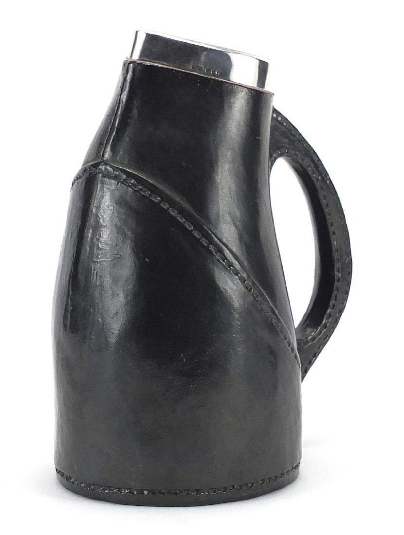 Royal Doulton Lambeth leather design jug with silver rim, London 1932, 21cm high