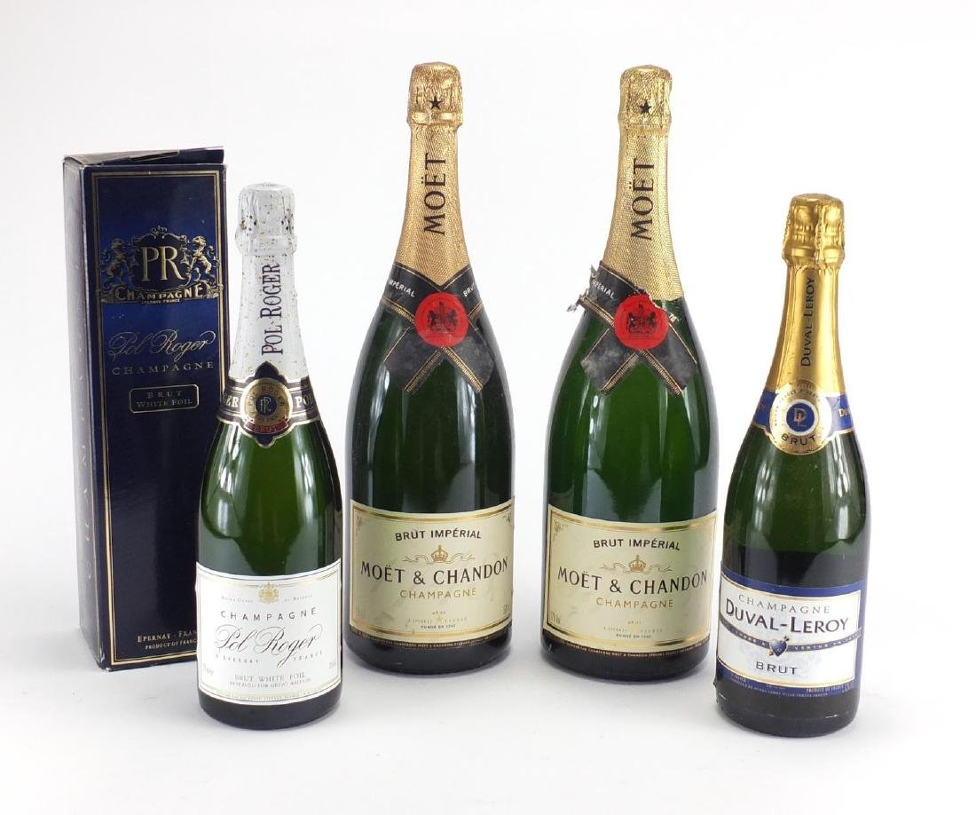 Four bottles of champagne including two Magnum Moet & Chandon and Pol Roger with box