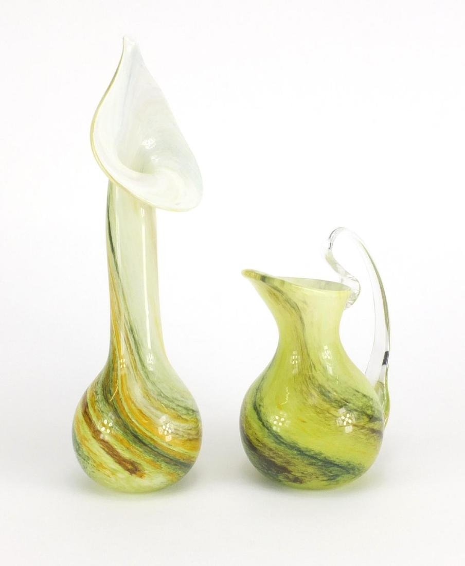 Isle of Wight glass jug and Jack In the Pulpit vase, one with paper label the largest 30cm high :