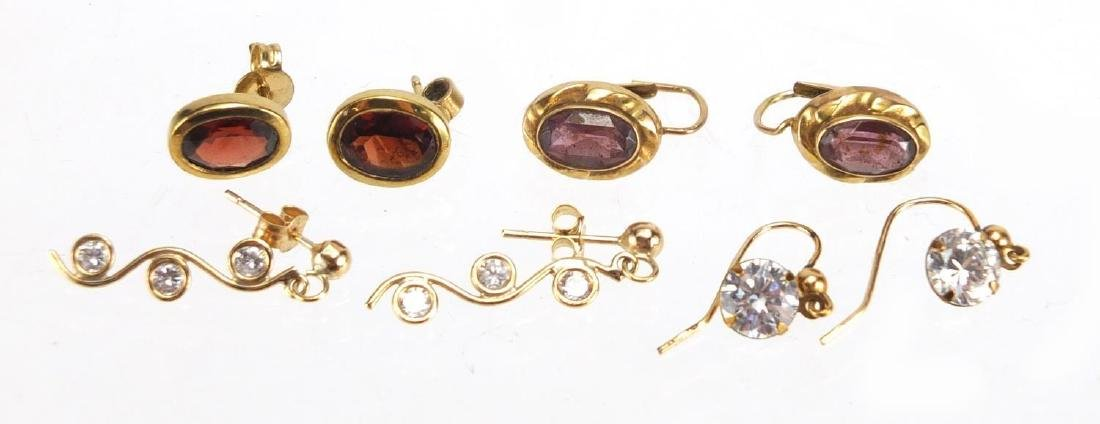 Four pairs of 9ct gold earrings set with garnets, amethyst and clear stones, approximate weight 5.4g