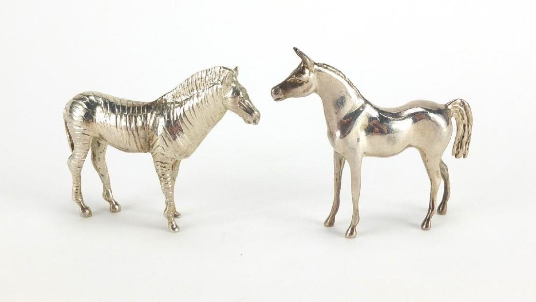 Two silver animals, zebra and horse, each stamped 925, the largest 5.5cm high, approximate weight