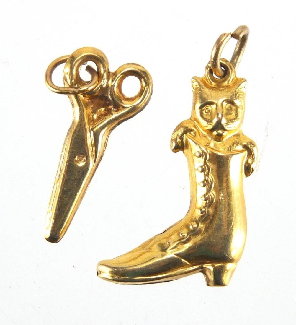 Two 9ct gold charms, cat in a boot and scissors, the largest 2cm in length, approximate weight 0.