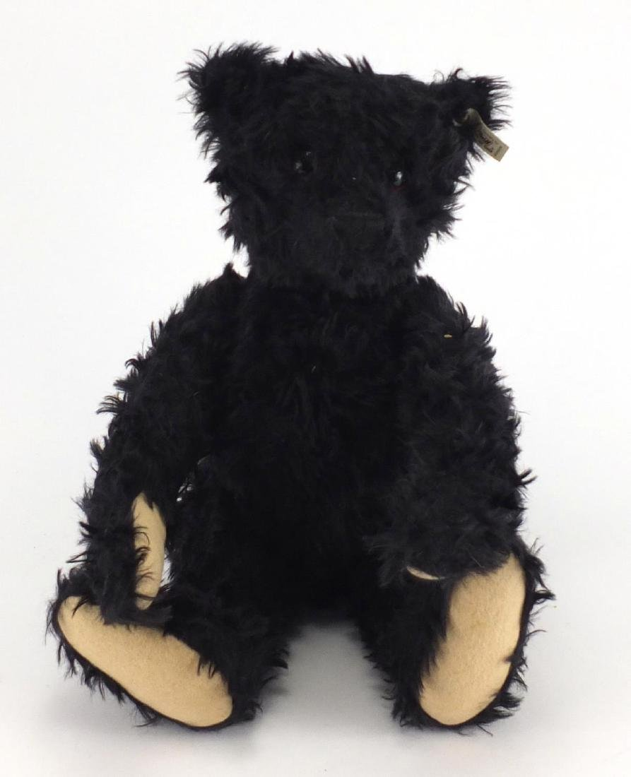 Large Steiff black bear with growler and button to one ear, 51cm high