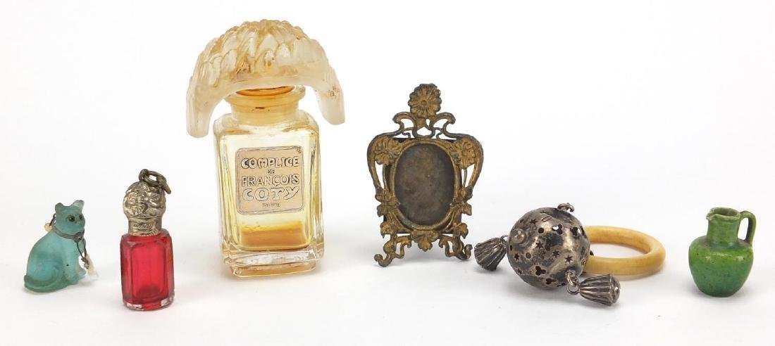 Miscellaneous objects including French perfume bottle, miniature brass easel photo frame, silver