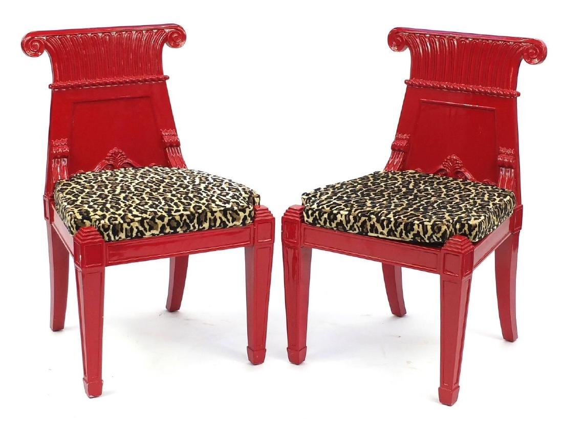Pair of Empire influenced red lacquered occasional chairs, with leopard pattern upholstered