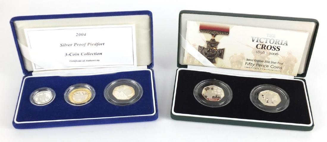 Two United Kingdom silver proof coin sets, 2006 The Victoria Cross fifty pence coins and 2004 silver