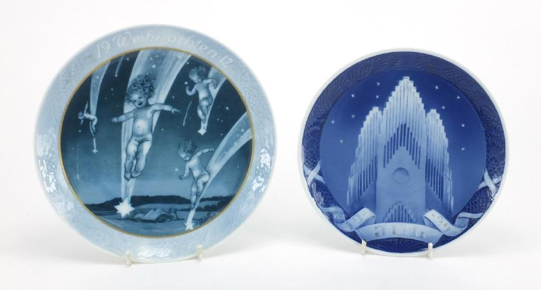 Royal Copenhagen 1929 Christmas plate and a 1912 Rosenthal example, the largest 20.5cm in diameter :
