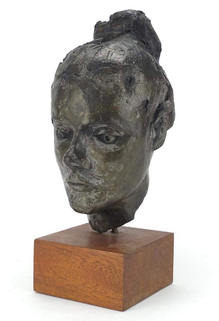 Bronzed bust of a female raised on a wooden block base, overall 40cm high