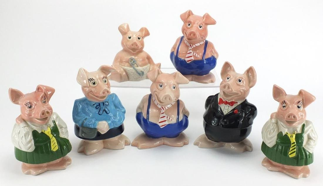 Seven Wade Natwest piggy banks, the largest 19cm high