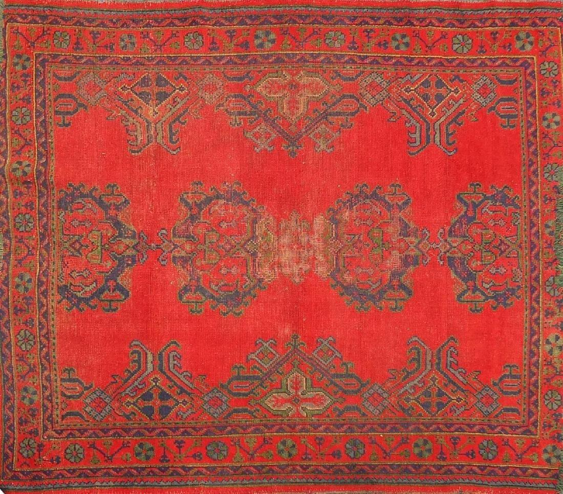 Rectangular Turkish Oushak rug, having a stylised floral design onto a red ground, 215cm x 178cm :