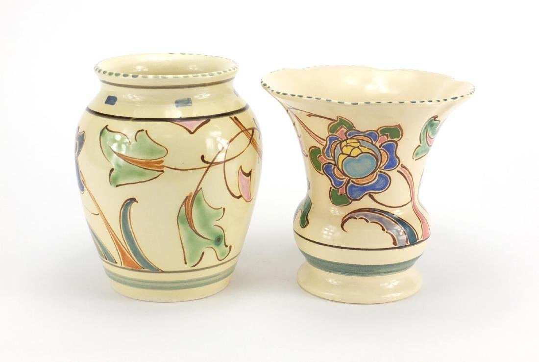 Two Honiton vases, both hand painted with stylised flowers, the largest 18cm high