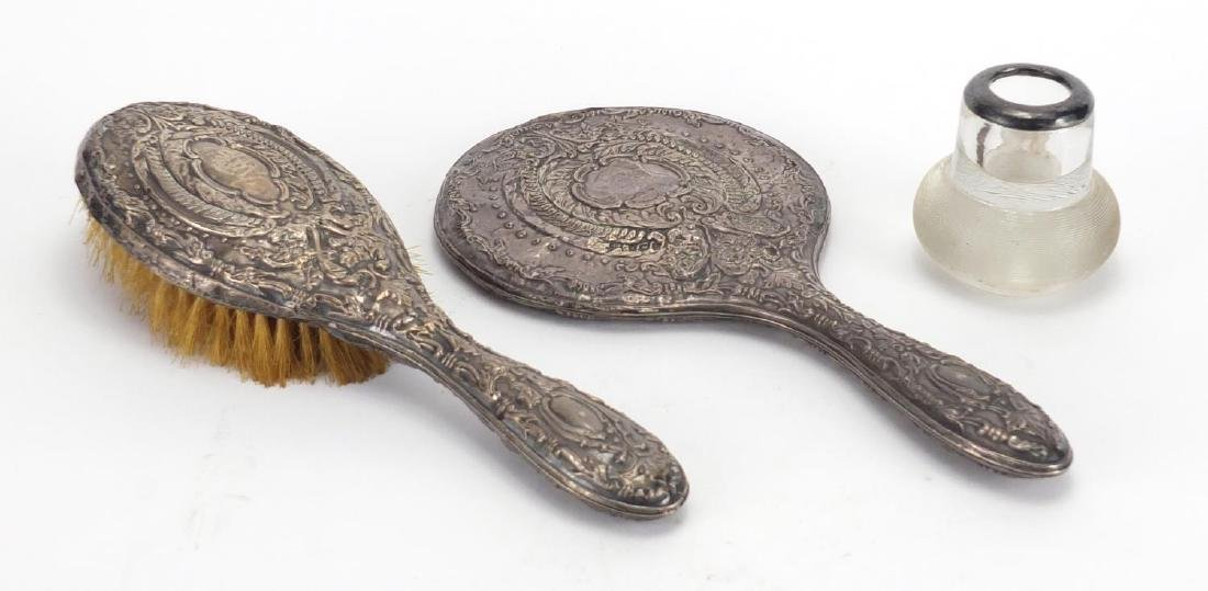 Silver items, match striker with silver rim, silver backed hand mirror and brush, various hallmarks,